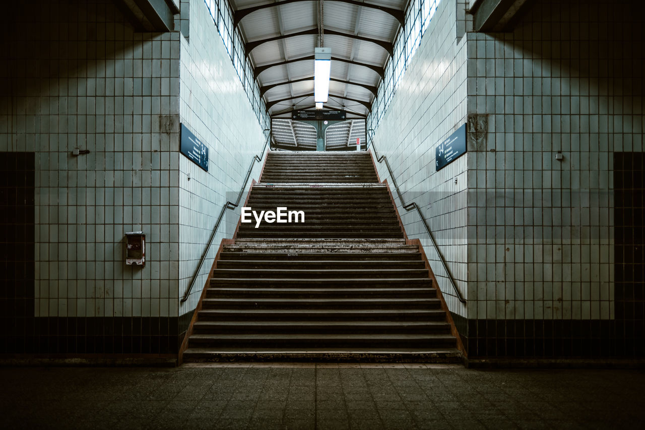 Steps in illuminated corridor