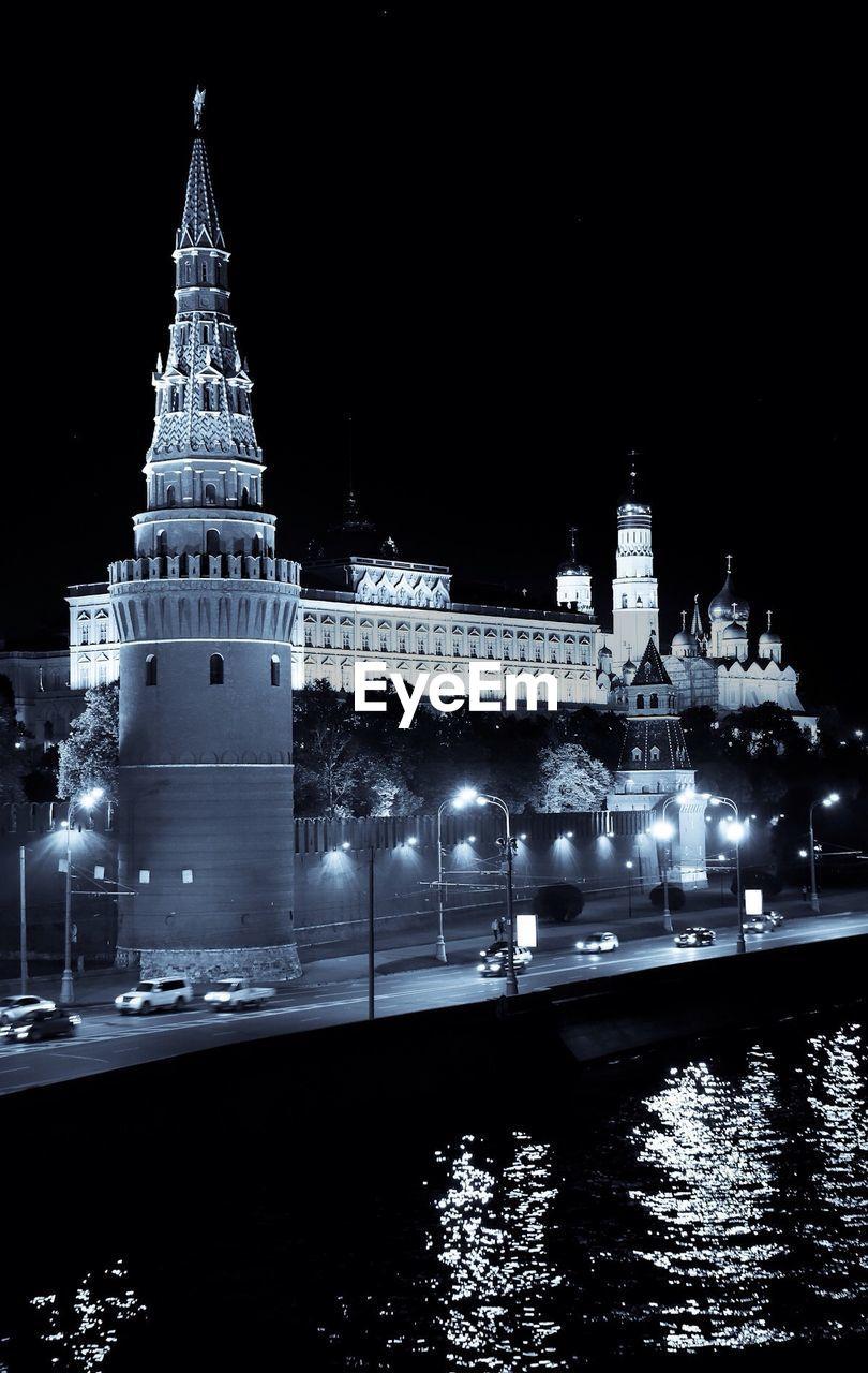 Illuminated Building Across River