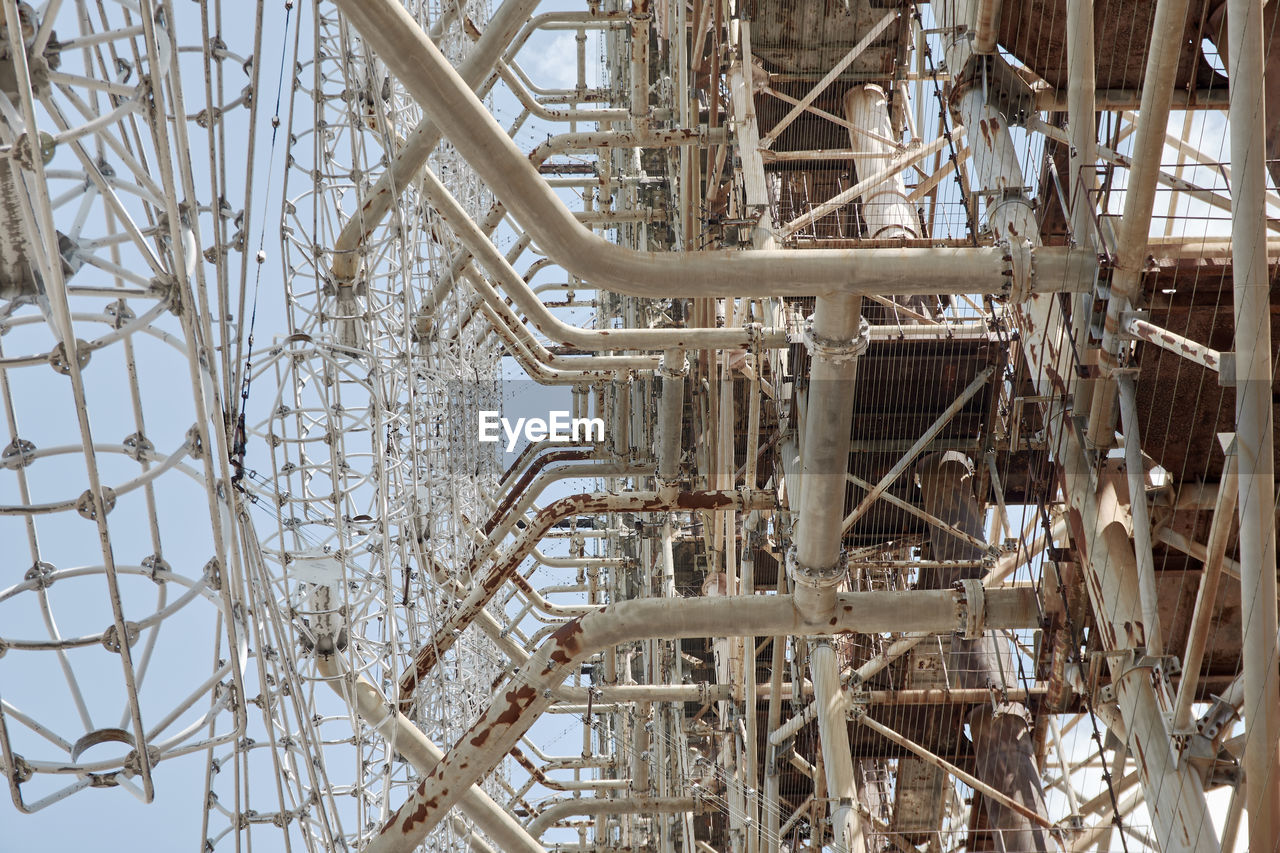 LOW ANGLE VIEW OF METAL STRUCTURE AGAINST SKY
