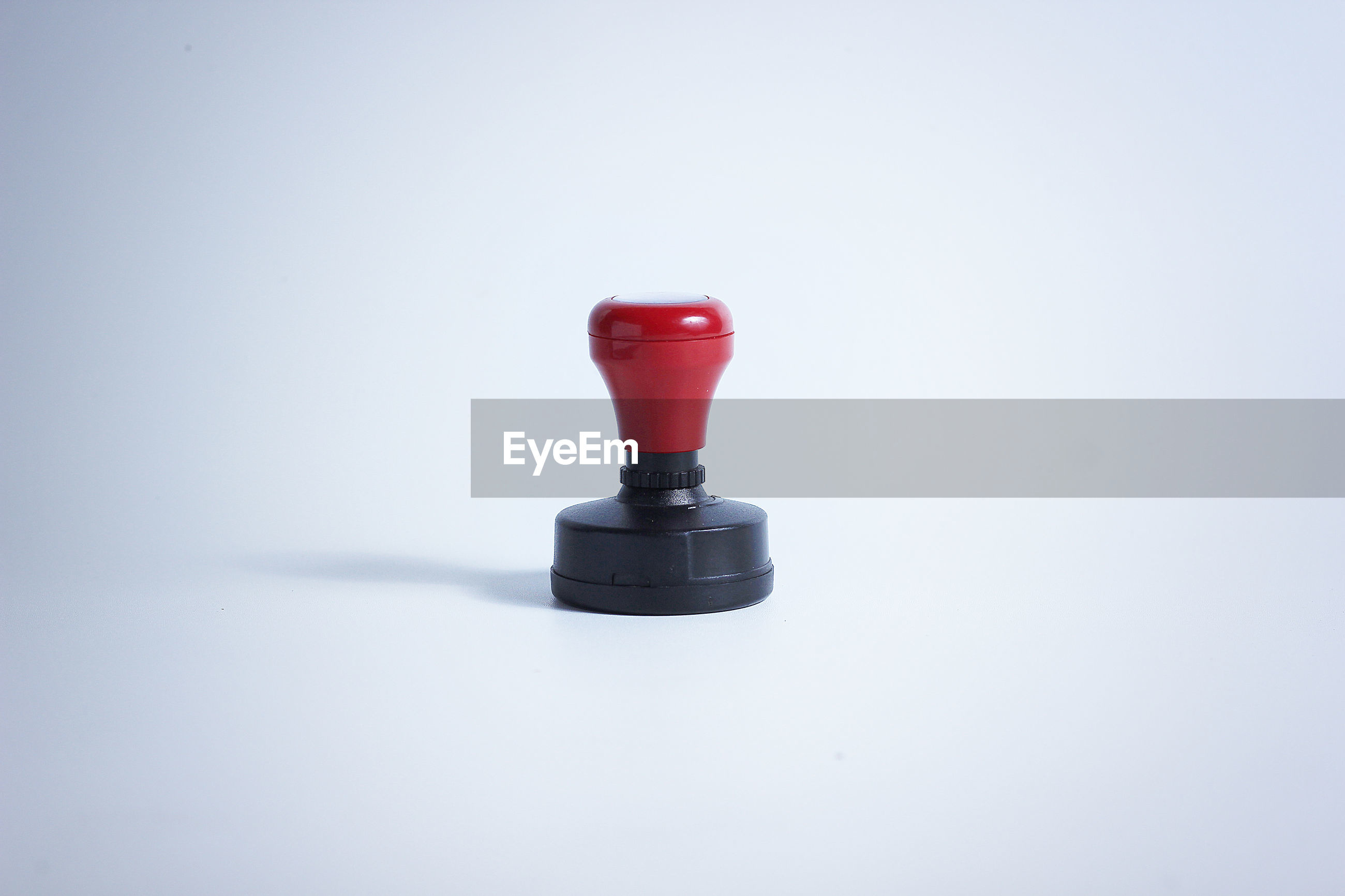 Close-up of rubber stamp against white background