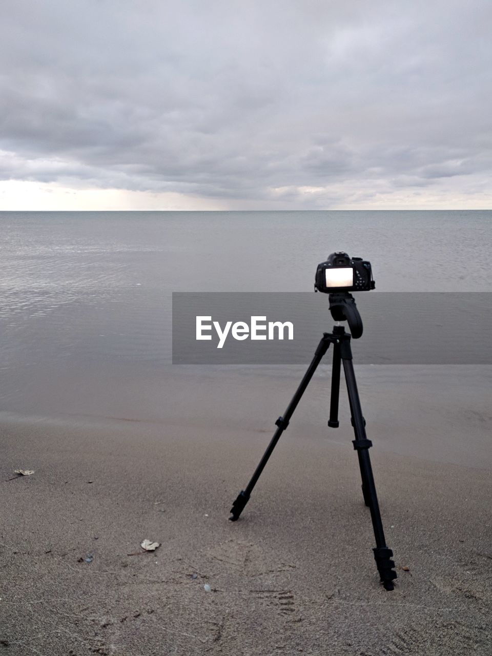 photography themes, camera - photographic equipment, technology, water, sky, photographic equipment, sea, cloud - sky, horizon, beach, land, tripod, camera, scenics - nature, digital camera, beauty in nature, horizon over water, tranquility, tranquil scene, no people, outdoors, slr camera, home video camera