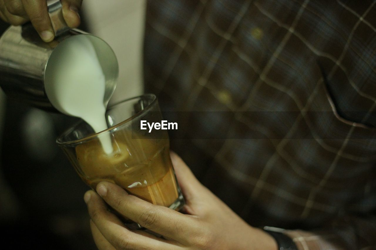 refreshment, drink, food and drink, human hand, hand, holding, one person, glass, real people, human body part, drinking glass, indoors, household equipment, close-up, freshness, lifestyles, women, focus on foreground, drinking, human limb, tea cup, finger