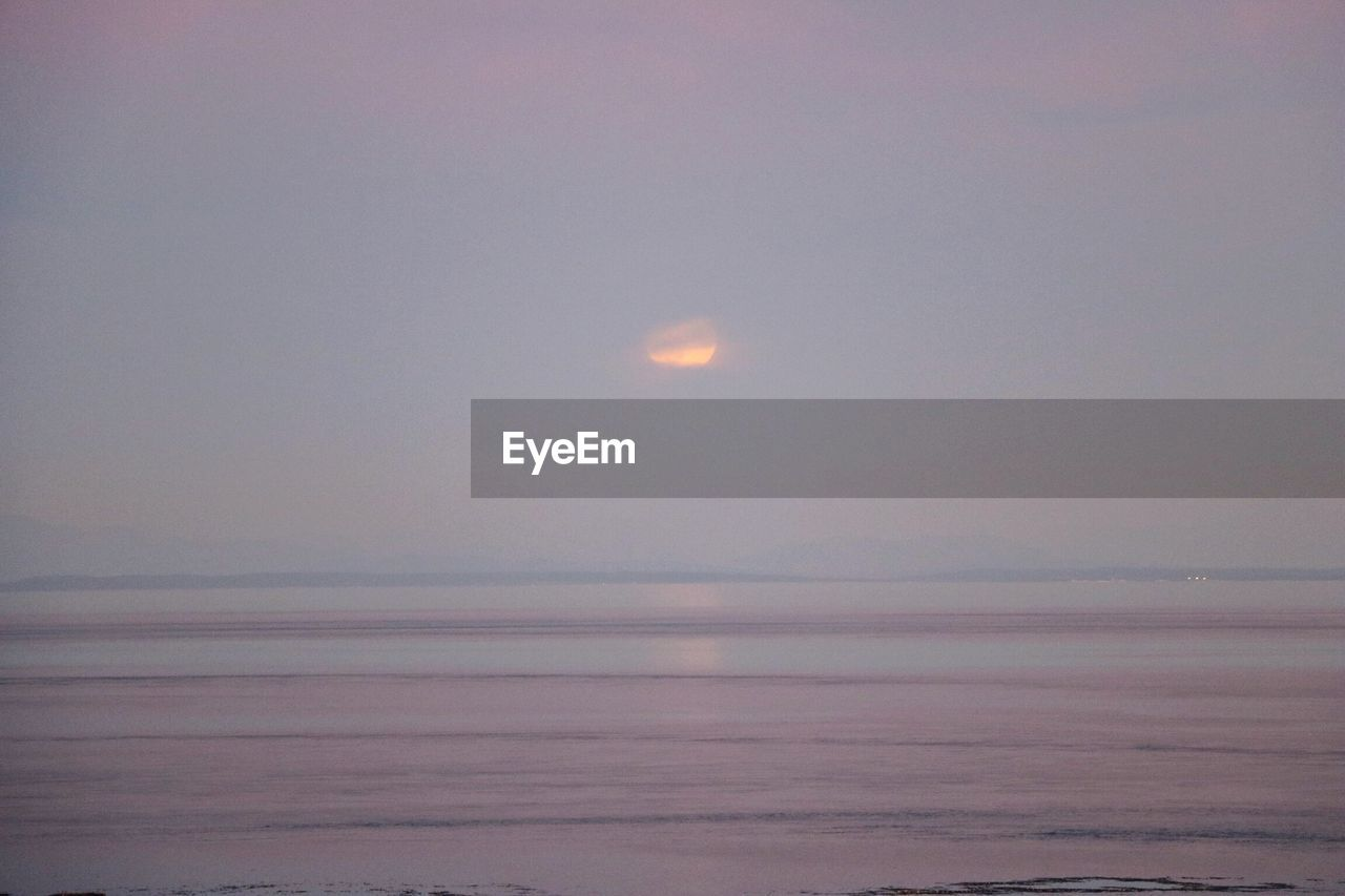 scenics, beauty in nature, tranquil scene, tranquility, nature, sea, no people, moon, water, outdoors, sky, horizon over water, sunset, day, astronomy