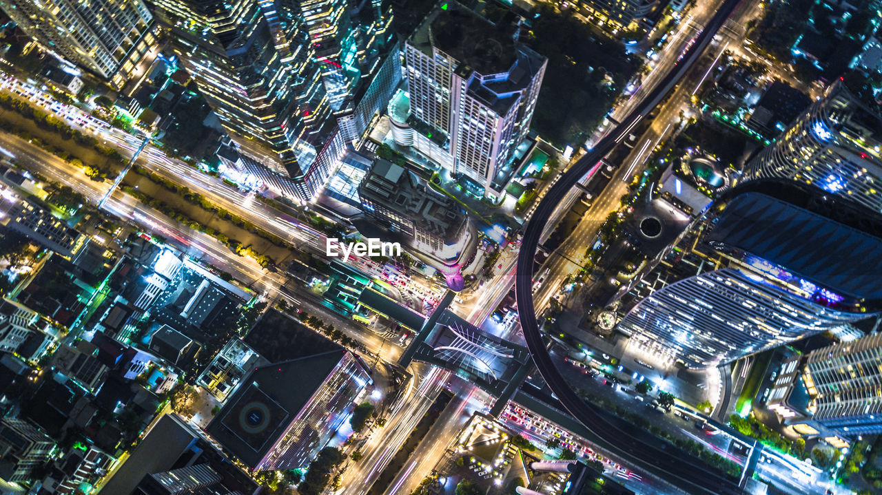 architecture, building exterior, city, illuminated, cityscape, built structure, high angle view, night, modern, skyscraper, city life, aerial view, outdoors, no people, road, travel destinations, downtown district, urban skyline