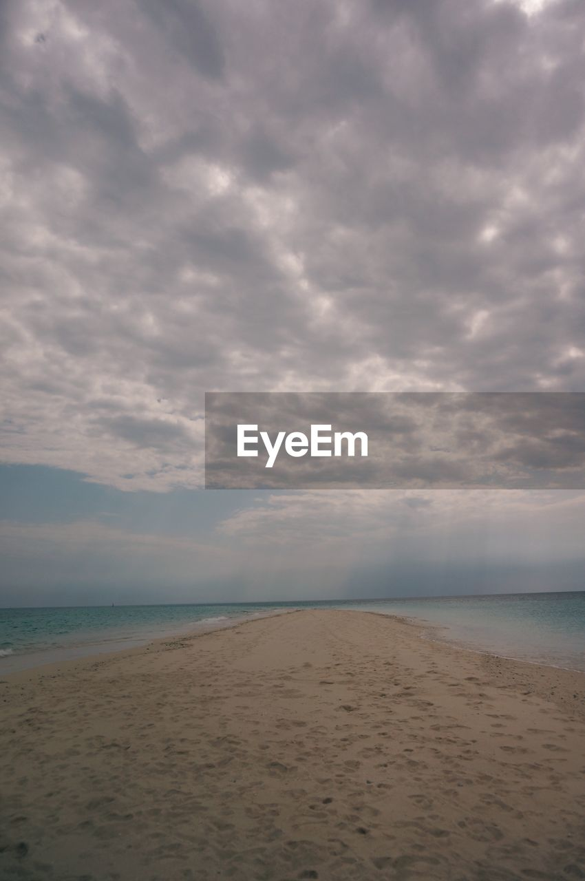 sea, beach, sky, water, sand, cloud - sky, nature, scenics, tranquility, horizon over water, tranquil scene, beauty in nature, no people, outdoors, day, travel destinations, storm cloud