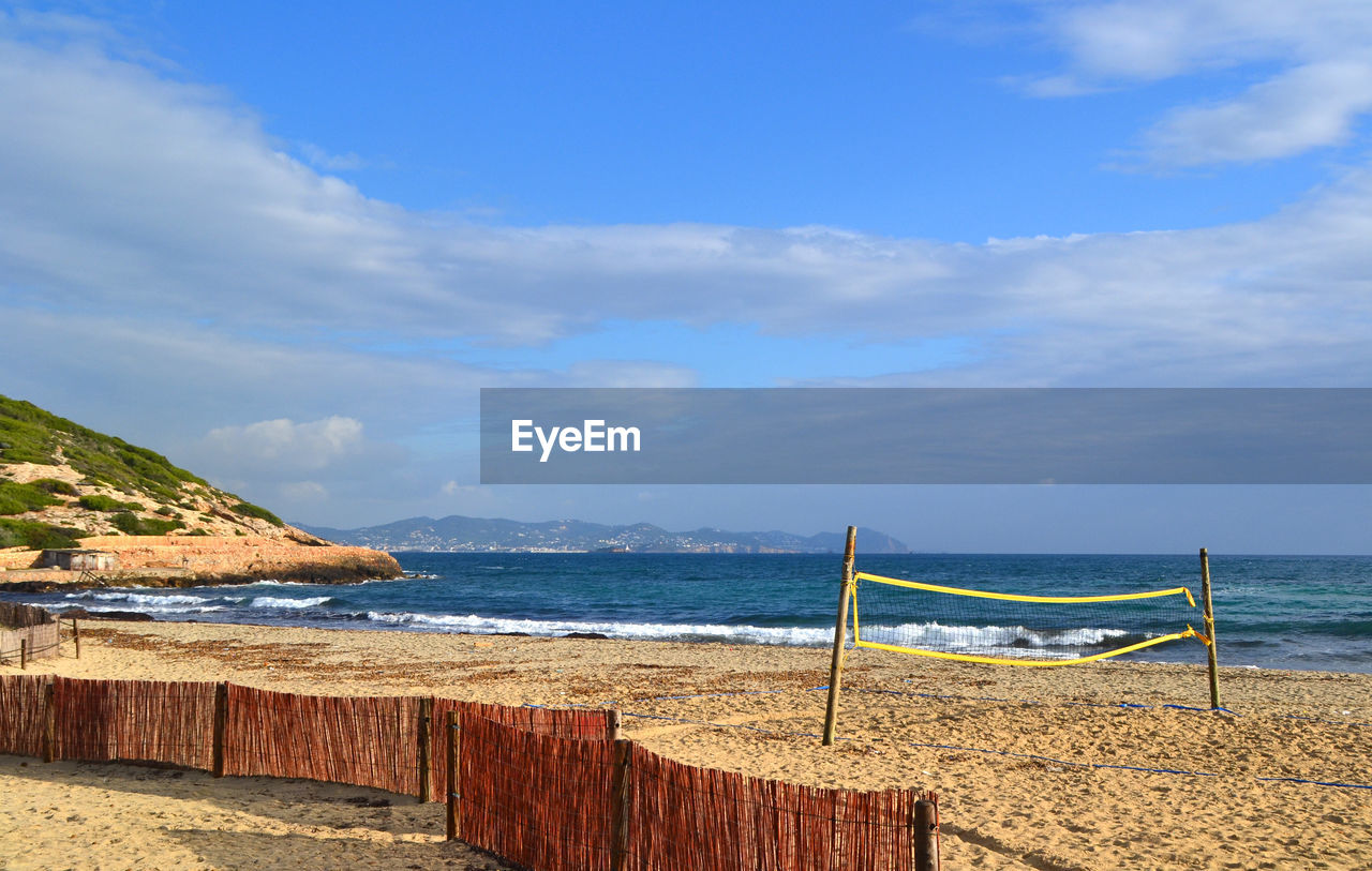 High angle view of empty beach against cloudy sky
