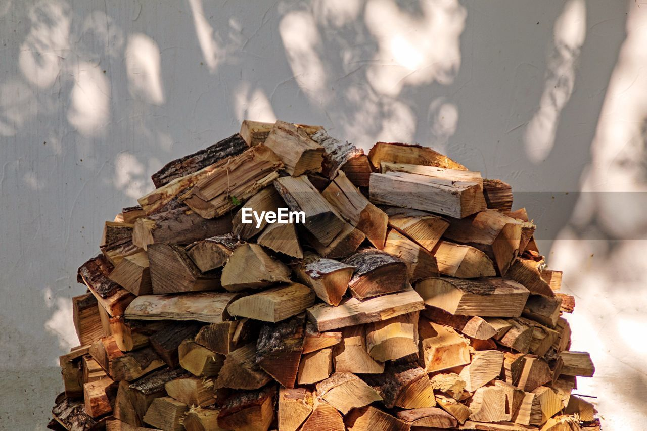 large group of objects, nature, no people, sunlight, high angle view, heap, day, abundance, outdoors, stack, close-up, focus on foreground, still life, paper, brown, wood, container, wood - material, firewood