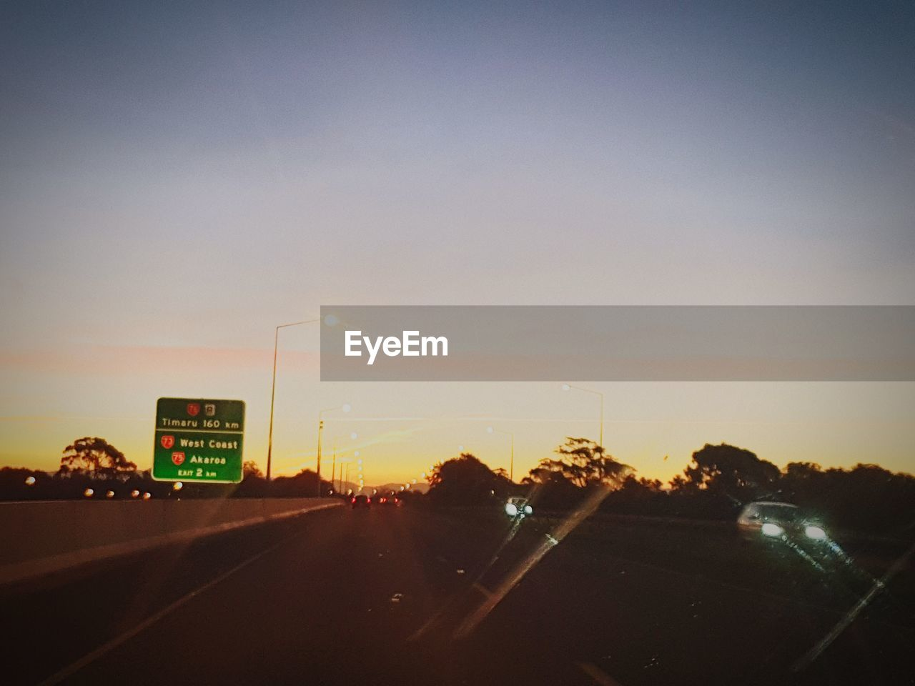 sunset, car, no people, sky, road, transportation, land vehicle, outdoors, illuminated, nature, beauty in nature, day
