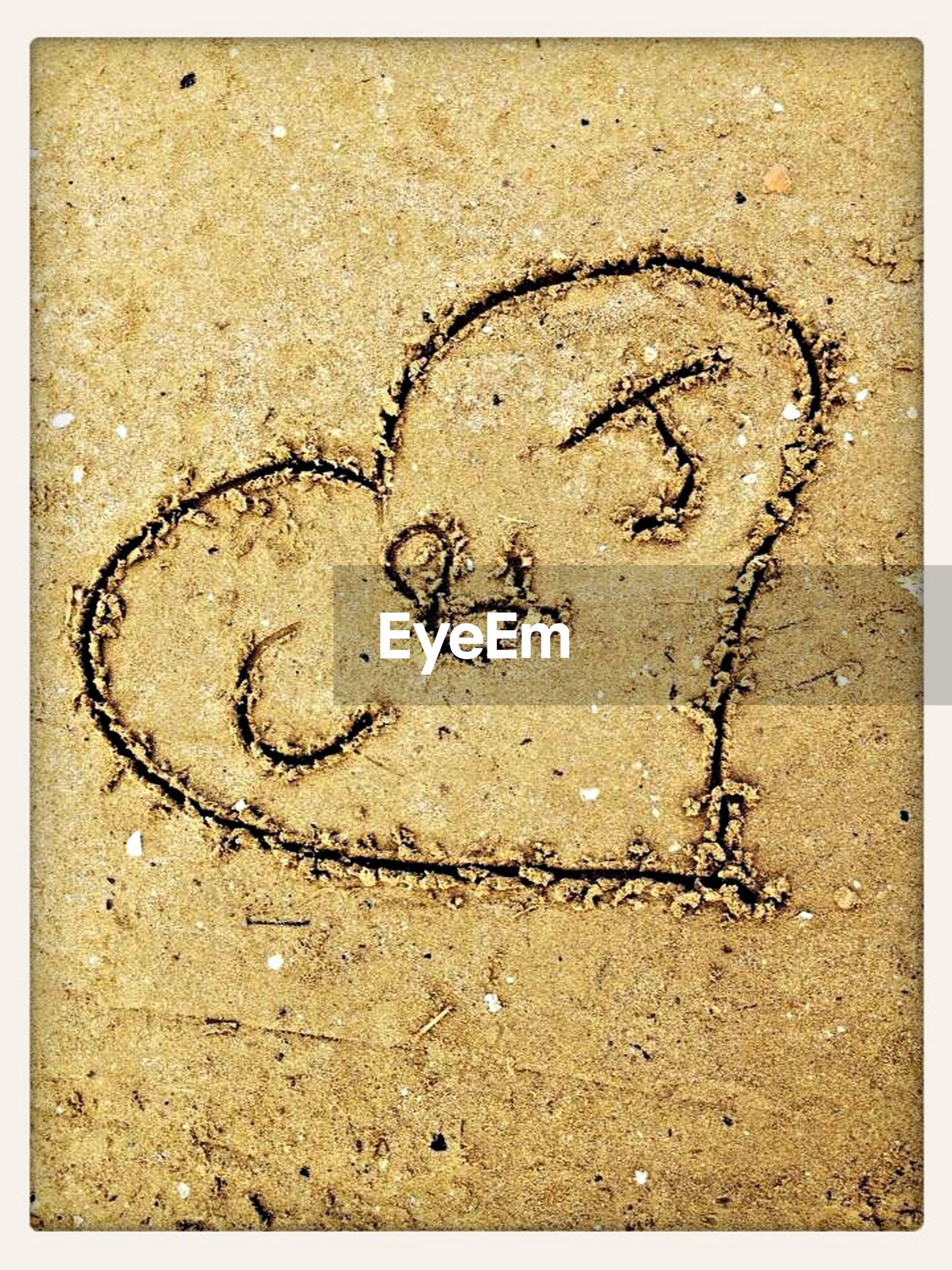 communication, text, western script, love, heart shape, close-up, textured, creativity, capital letter, art, high angle view, art and craft, full frame, ideas, number, sand, symbol, circle, shape, no people