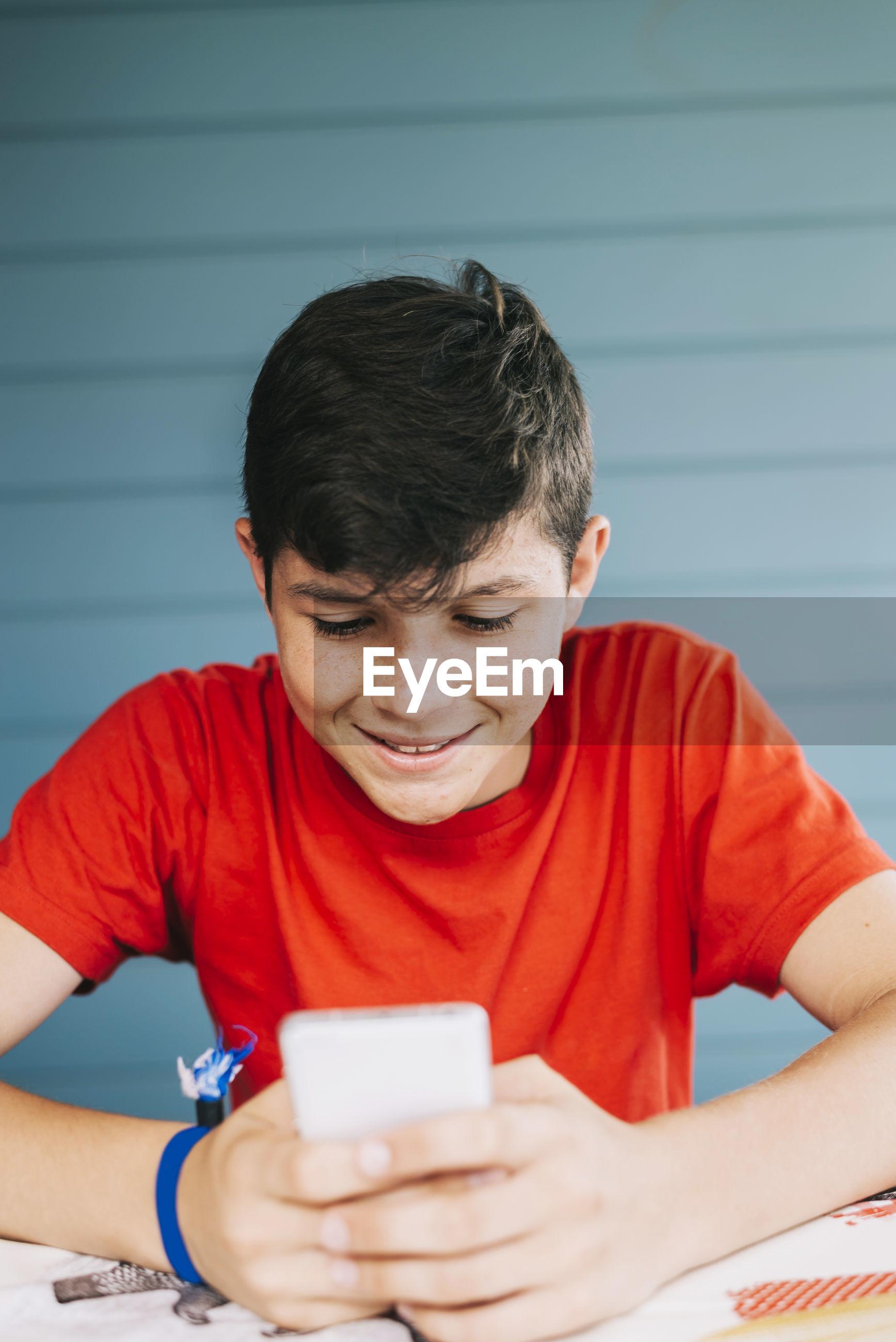 Teenage boy using phone