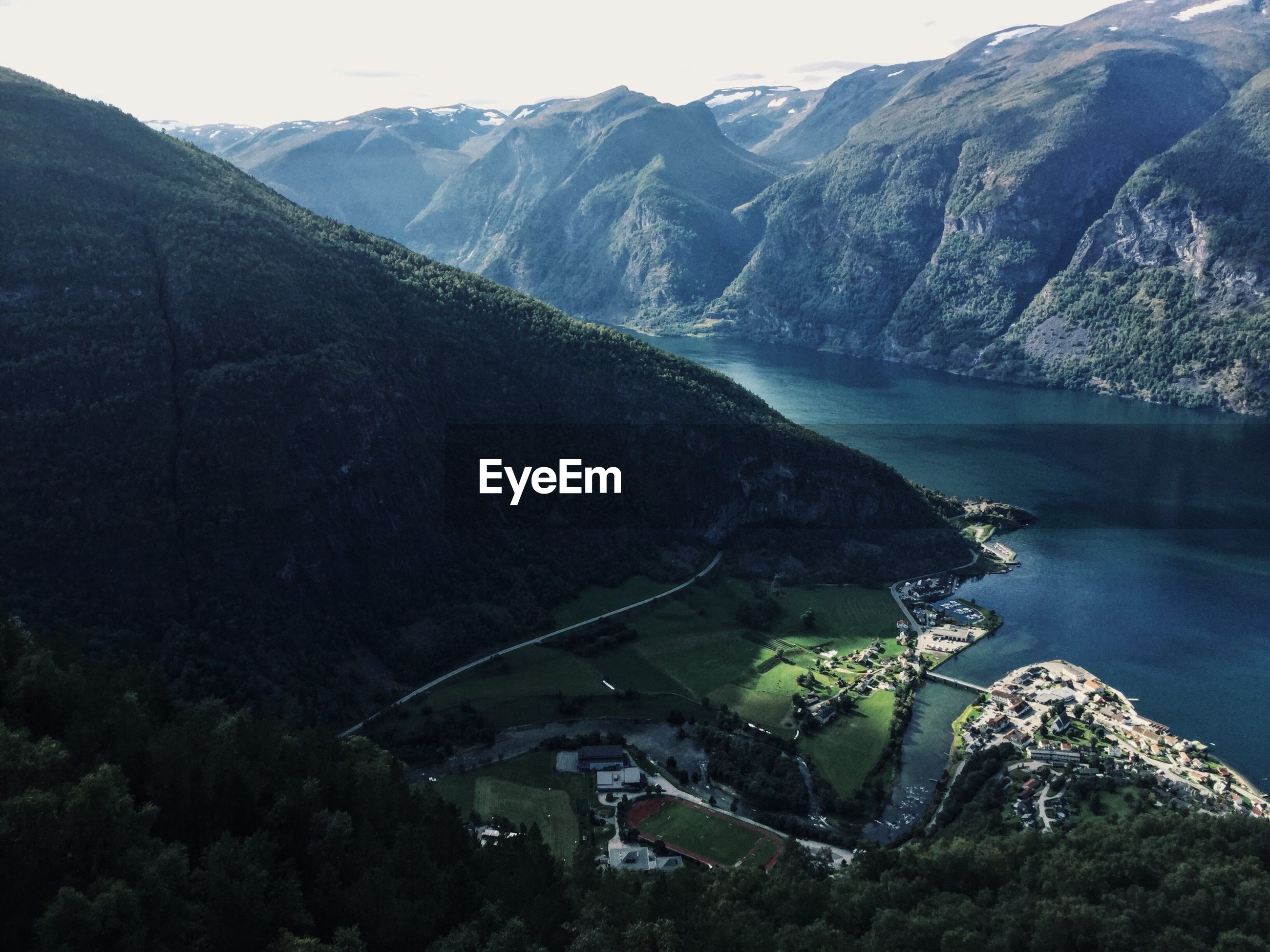 HIGH ANGLE VIEW OF LAKE AGAINST MOUNTAINS