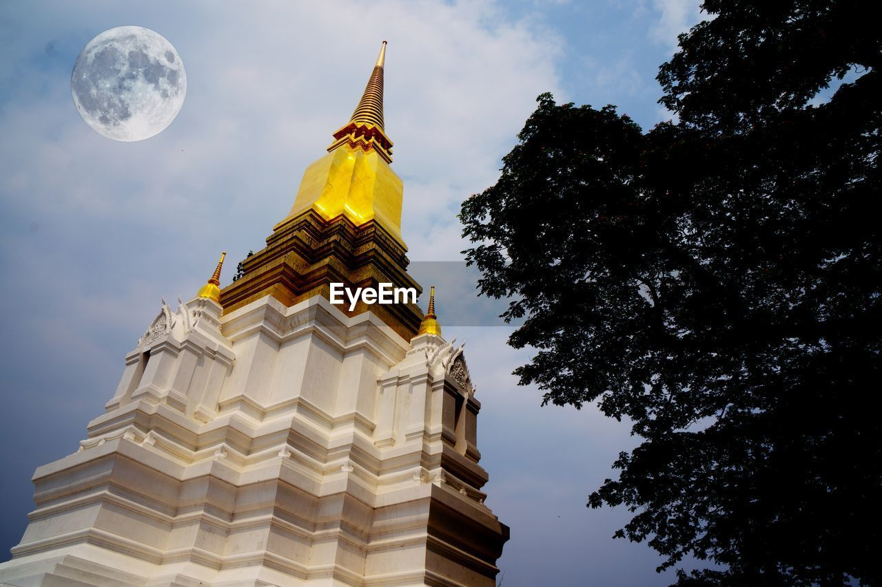 LOW ANGLE VIEW OF TEMPLE AGAINST SKY AND TREES