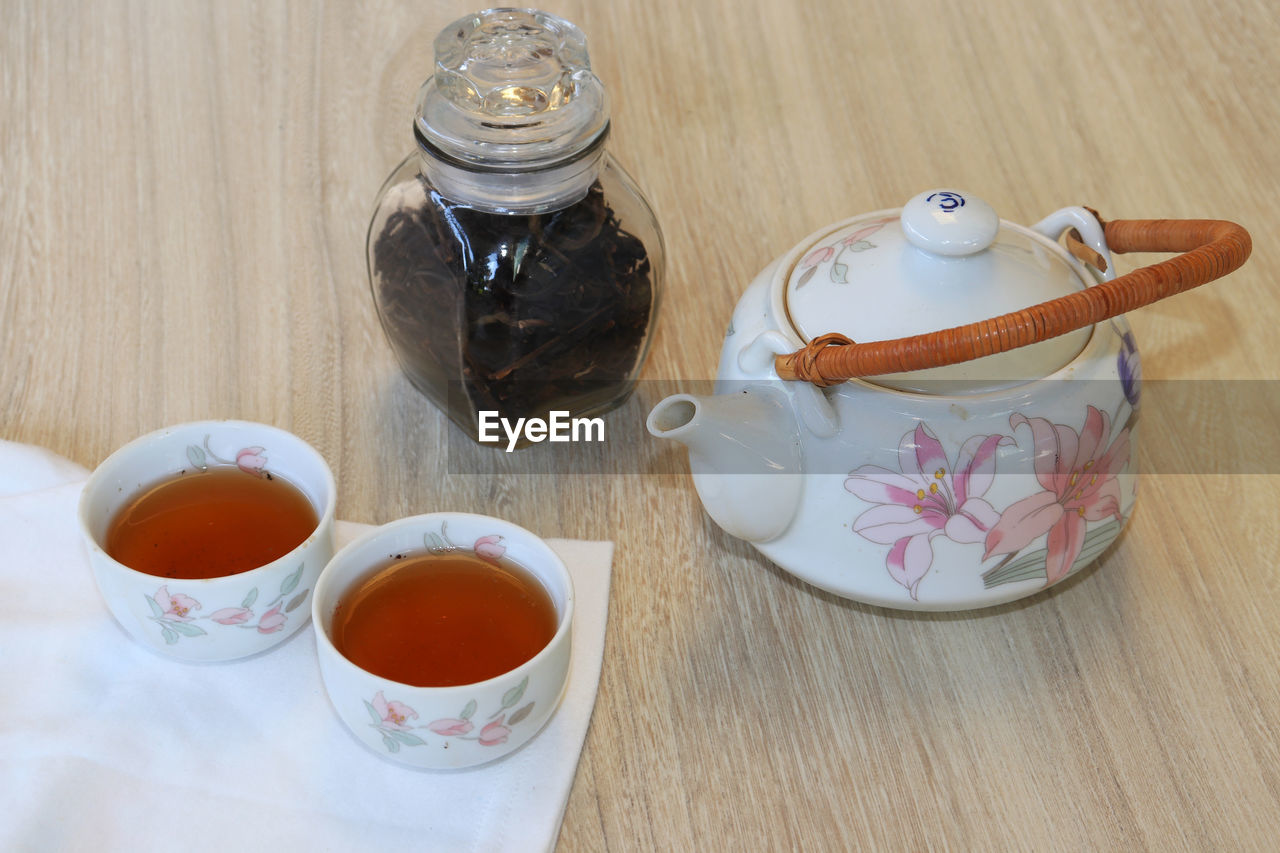 drink, food and drink, refreshment, table, tea - hot drink, cup, tea, teapot, hot drink, food, mug, indoors, tea cup, high angle view, freshness, container, no people, still life, close-up, saucer, crockery, breakfast