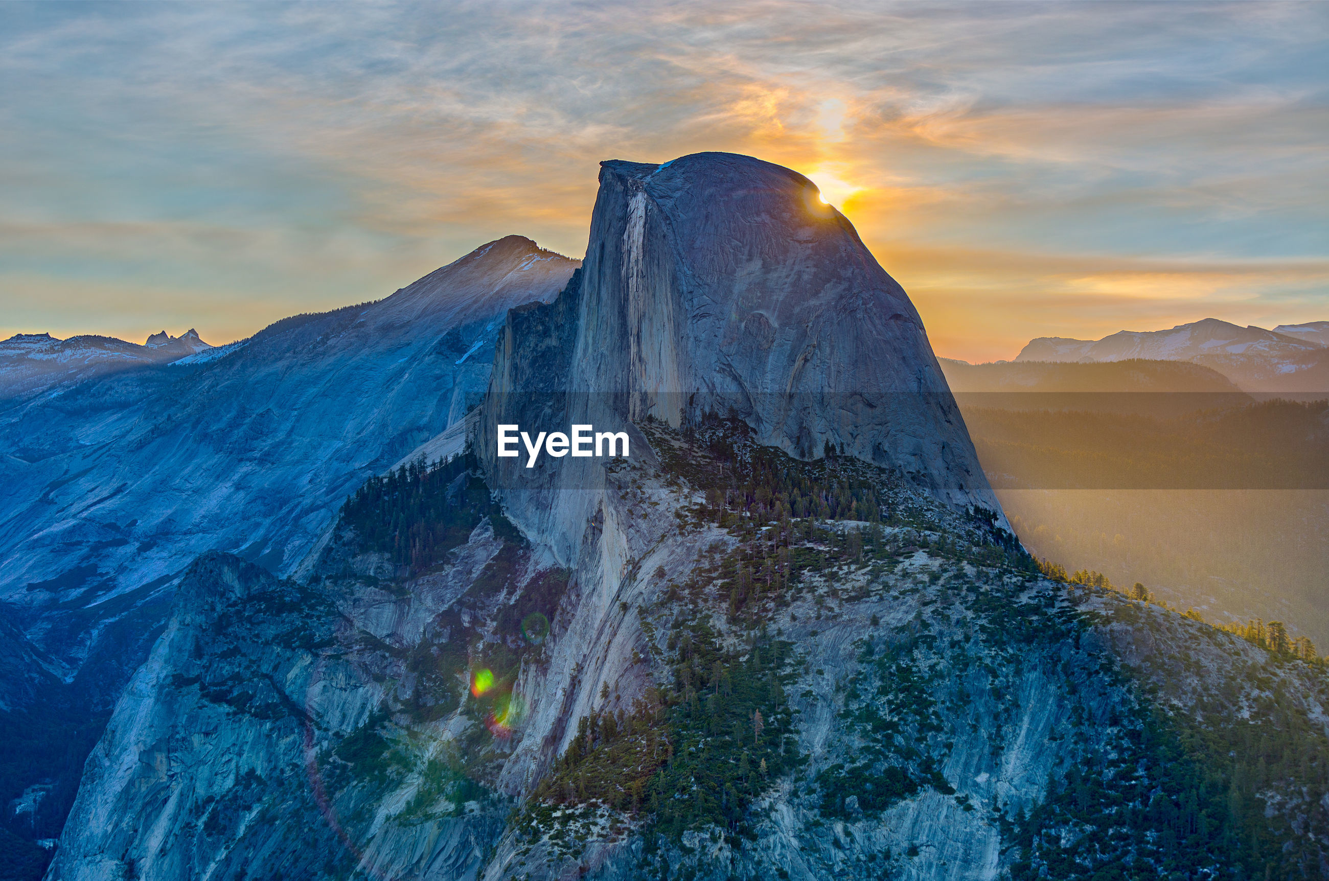 Scenic view of half dome mountain against sky at sunrise