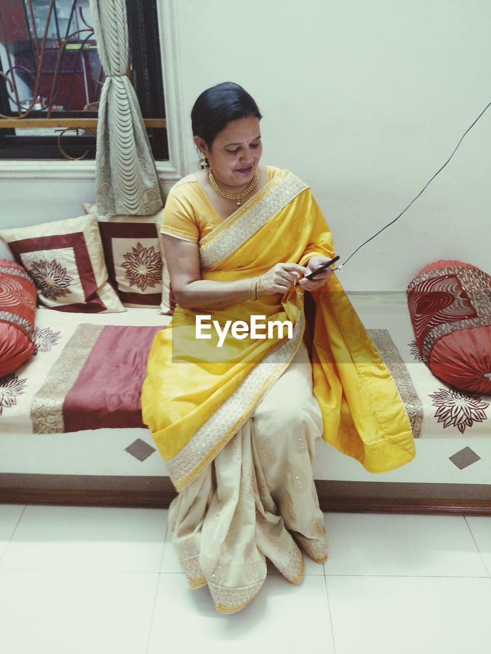 traditional clothing, one person, real people, sari, front view, full length, happiness, smiling, indoors, young adult, day, young women