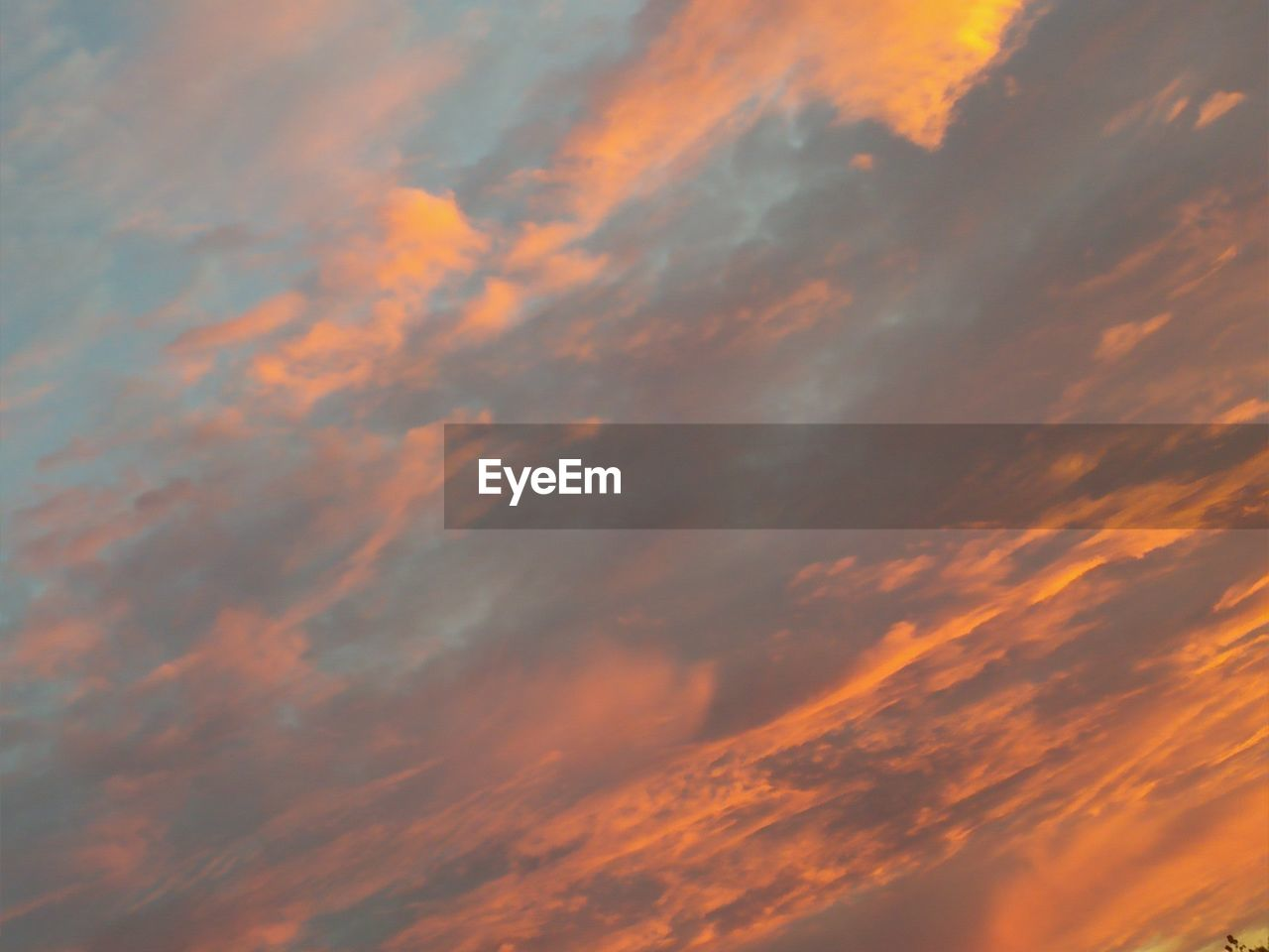 sky, cloud - sky, beauty in nature, sunset, scenics - nature, orange color, tranquility, low angle view, tranquil scene, backgrounds, no people, full frame, idyllic, nature, dramatic sky, outdoors, cloudscape, moody sky, awe, meteorology, ominous