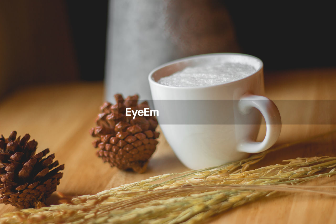 food and drink, cup, mug, coffee, still life, table, coffee - drink, coffee cup, food, indoors, drink, close-up, freshness, no people, refreshment, brown, focus on foreground, selective focus, roasted coffee bean, hot drink, crockery, tea cup