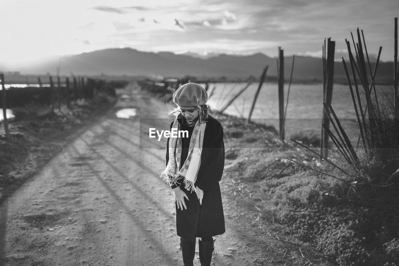 Teenage Girl Standing On Dirt Road