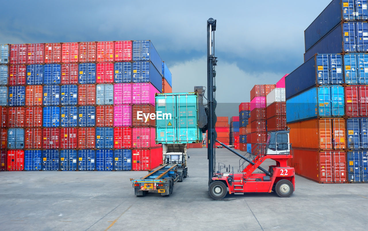 Forklift picking container at distribution warehouse