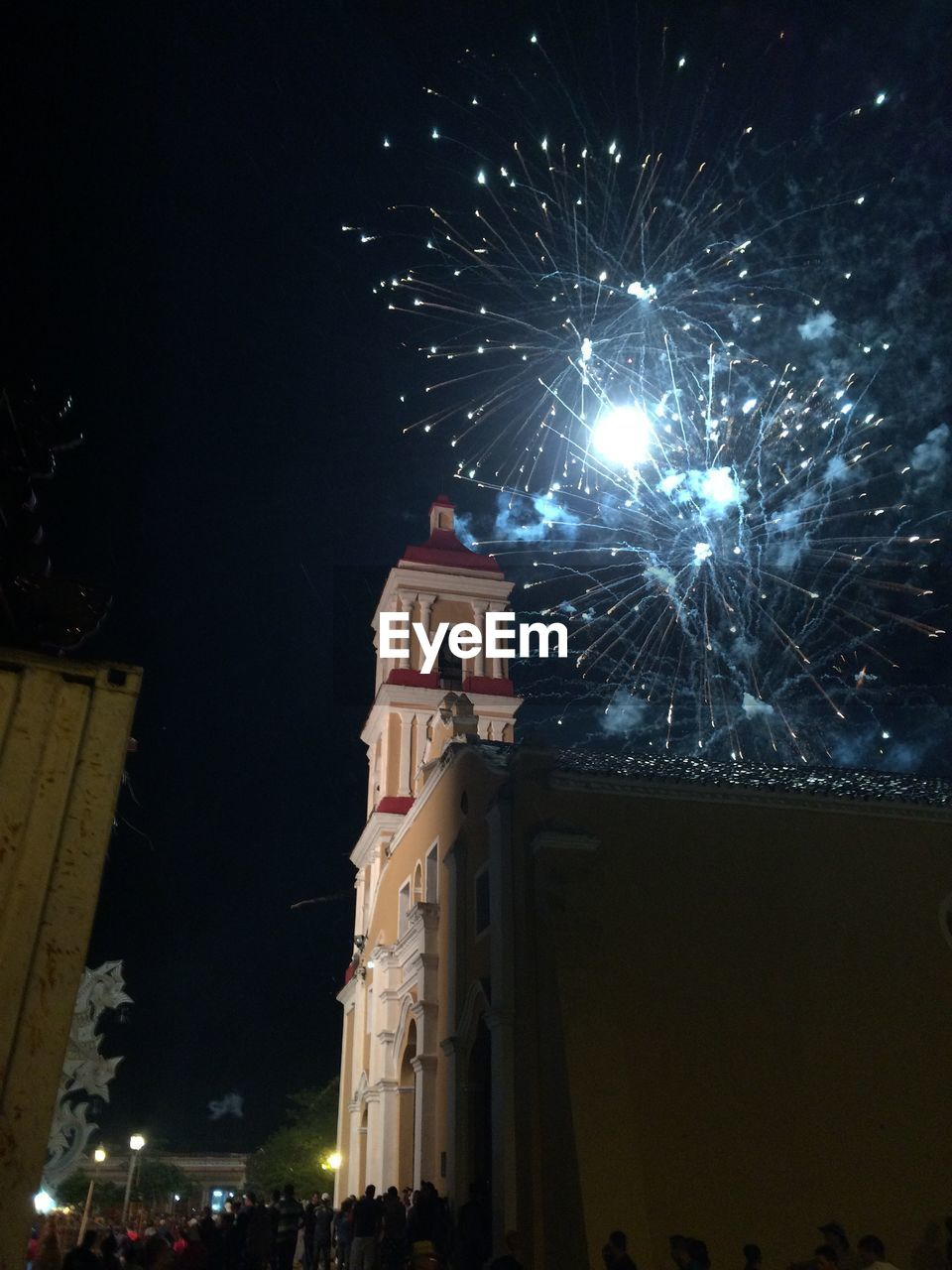 night, religion, illuminated, low angle view, celebration, building exterior, architecture, built structure, spirituality, place of worship, firework display, event, arts culture and entertainment, firework - man made object, outdoors, no people, sky
