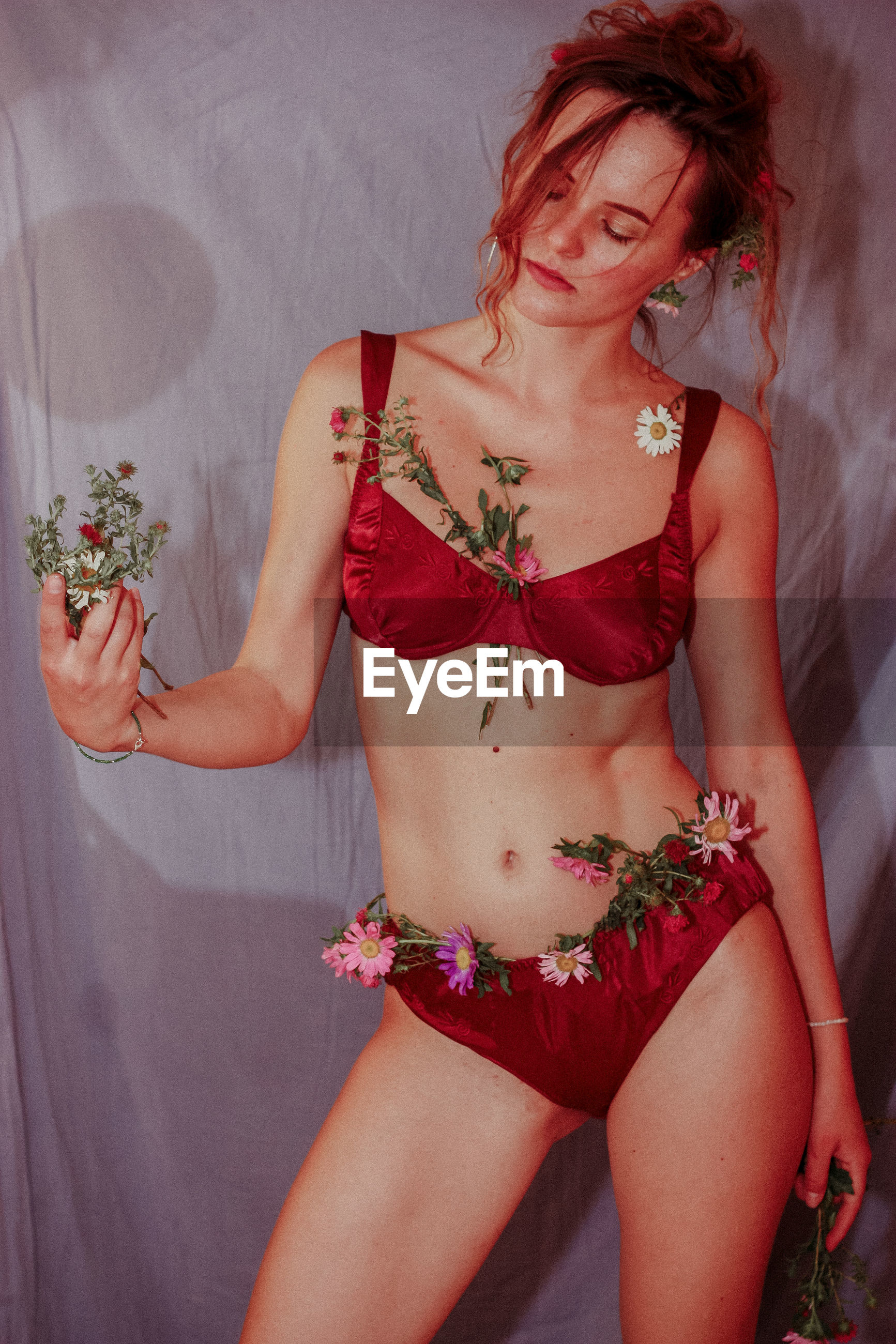 MIDSECTION OF WOMAN WITH PINK FLOWER IN HAIR