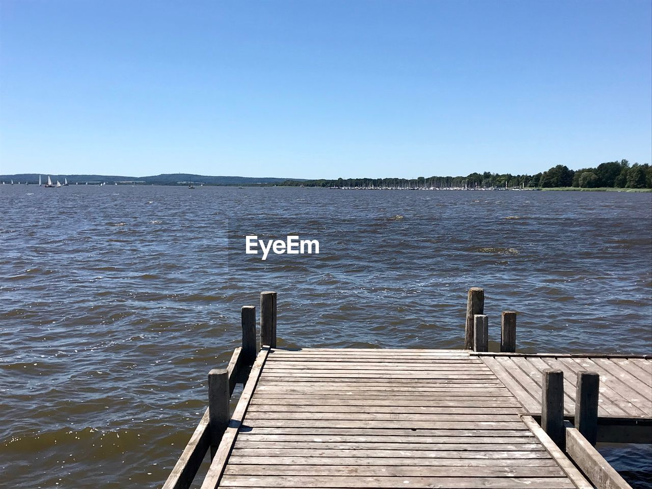 water, sky, clear sky, beauty in nature, tranquility, pier, nature, copy space, lake, wood - material, tranquil scene, scenics - nature, no people, day, jetty, architecture, the way forward, blue, outdoors, wood paneling