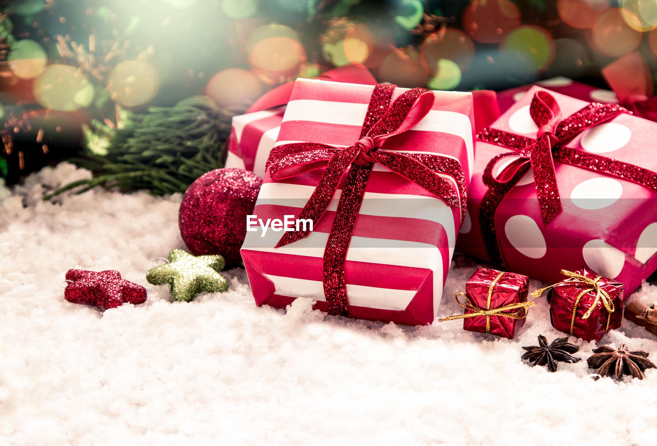 High angle view of christmas gifts on snow