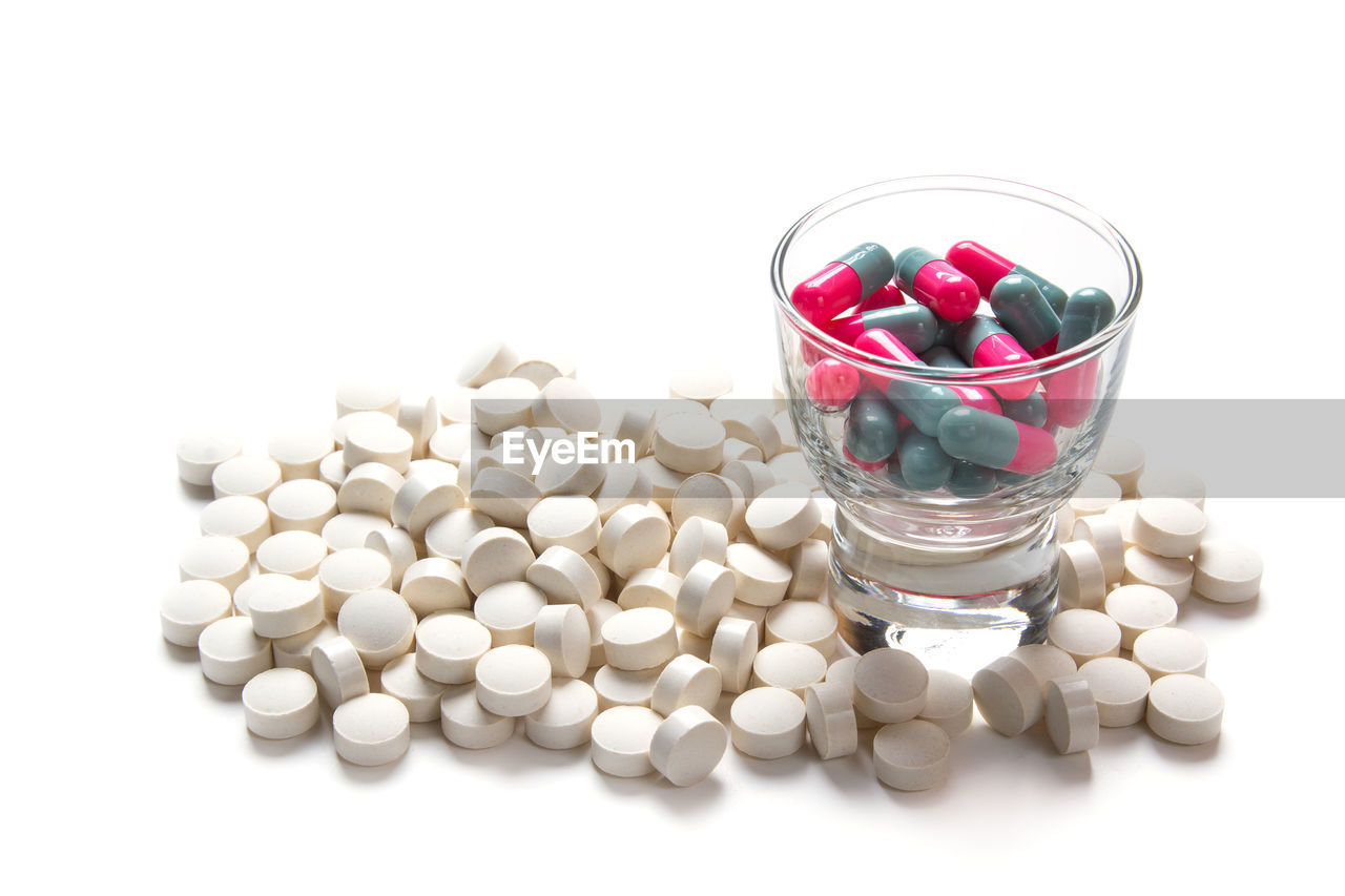Close-up of pills over white background