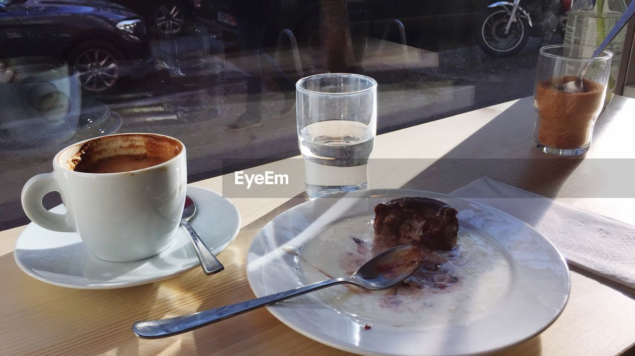 food and drink, drink, table, refreshment, coffee - drink, coffee cup, freshness, plate, indoors, drinking glass, food, serving size, saucer, indulgence, fork, frothy drink, sweet food, dessert, no people, ready-to-eat, cafe, day, temptation, close-up