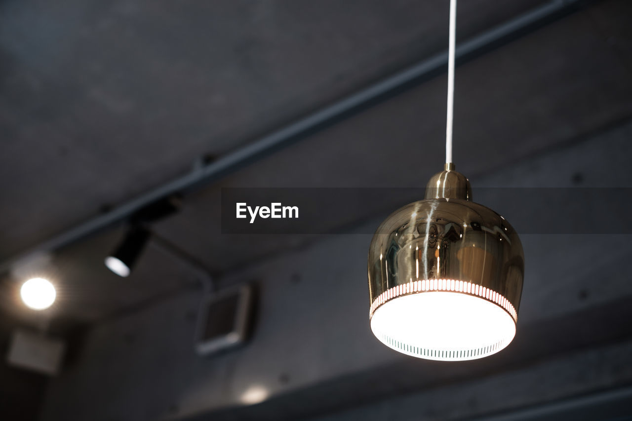 Low angle view of illuminated light hanging from ceiling