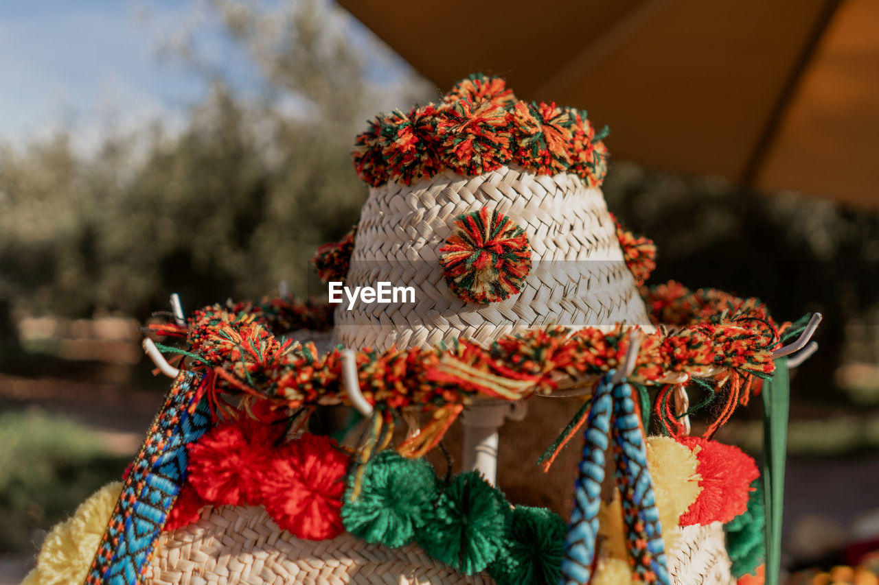 focus on foreground, close-up, decoration, art and craft, creativity, no people, celebration, textile, pattern, craft, day, wool, christmas, tree, plant, red, holiday, nature