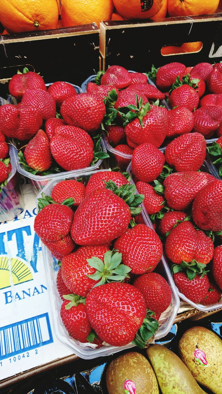 fruit, for sale, freshness, strawberry, market, food and drink, food, retail, red, healthy eating, no people, abundance, price tag, large group of objects, indoors, close-up, day