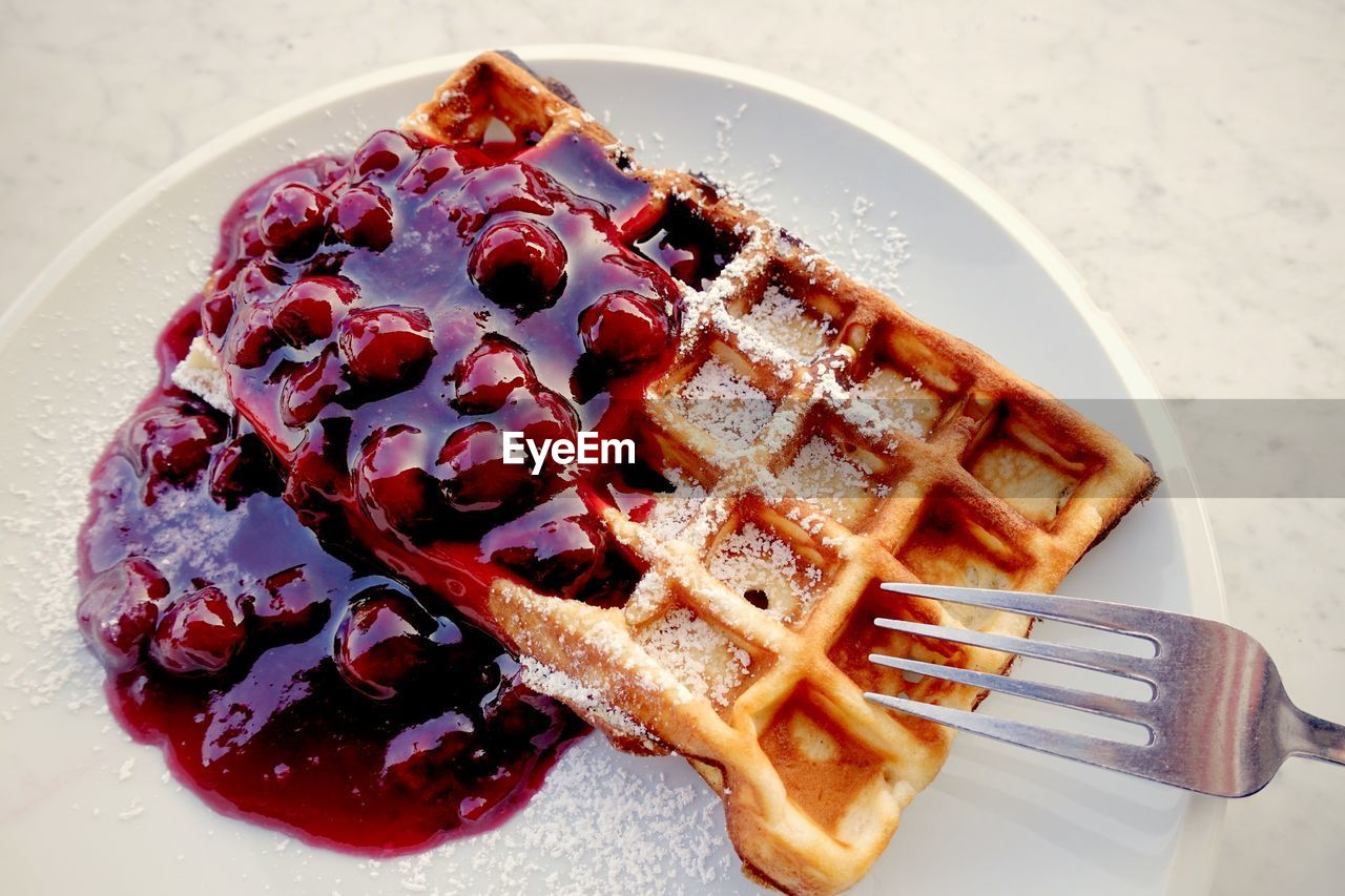 food, food and drink, ready-to-eat, plate, freshness, still life, sweet food, indulgence, kitchen utensil, unhealthy eating, dessert, fork, indoors, waffle, temptation, eating utensil, serving size, high angle view, no people, sweet, snack, syrup, breakfast