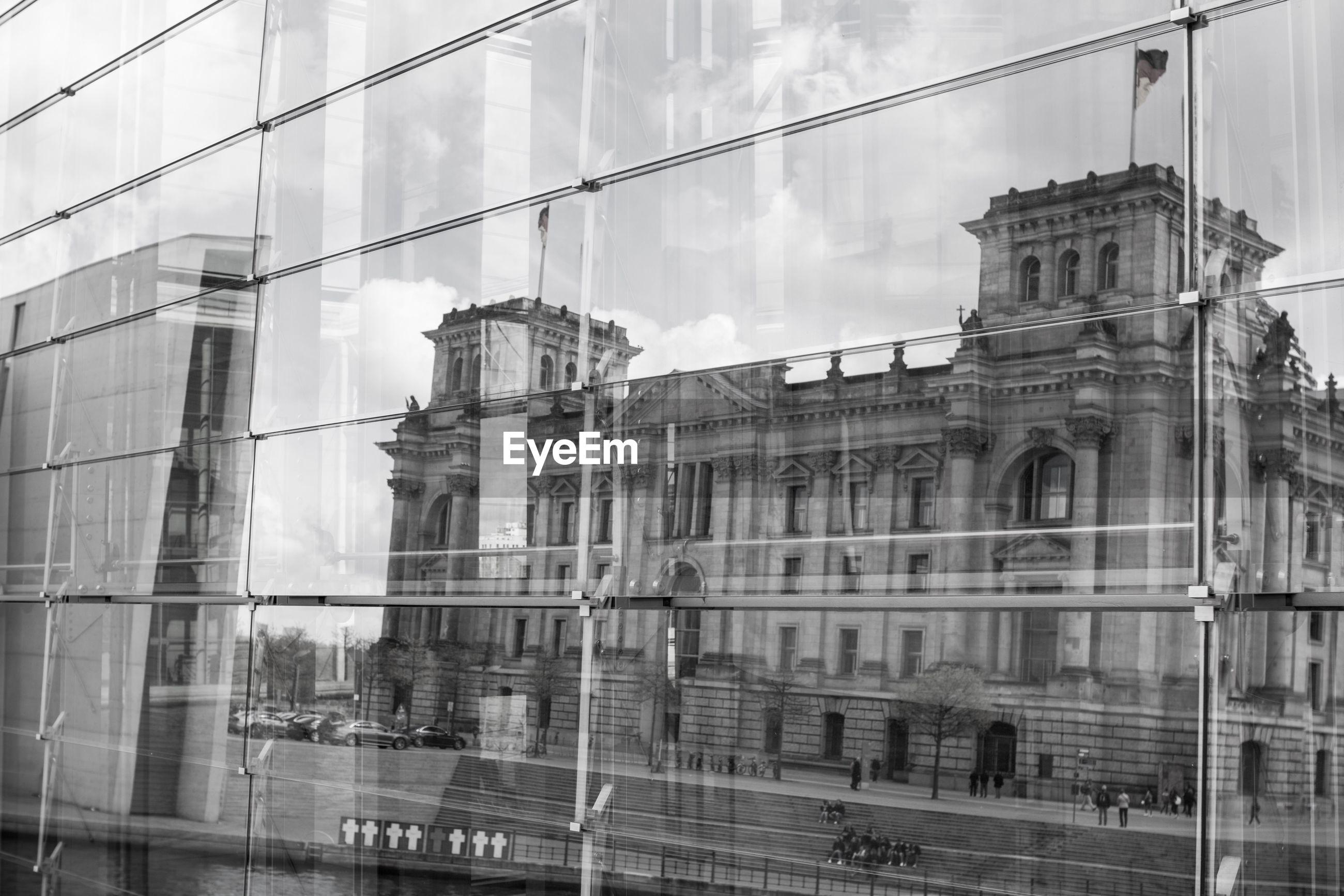 Building reflecting on glass window