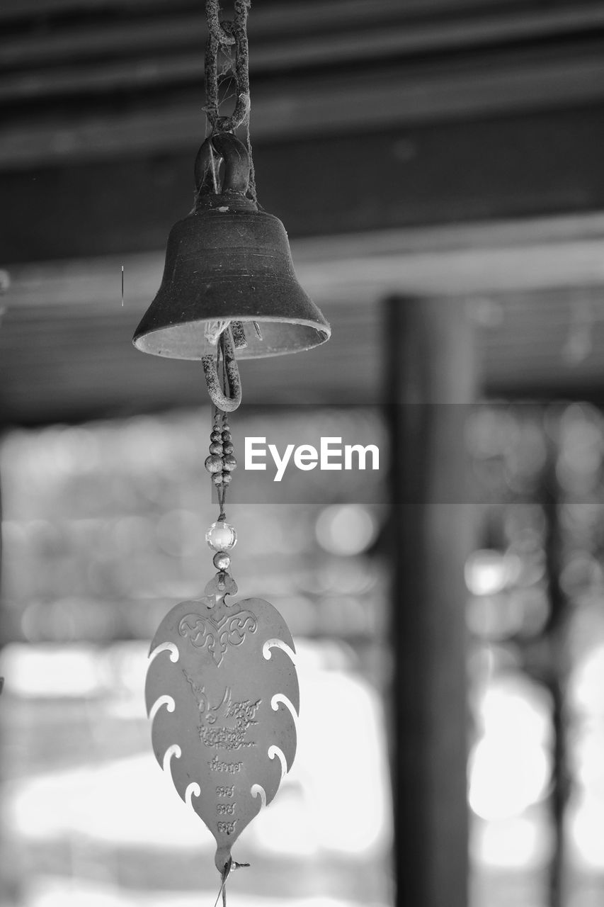 hanging, focus on foreground, metal, no people, close-up, day, heart shape, architecture, indoors, love, bell, built structure, positive emotion, decoration, lock, hope, belief, ceiling