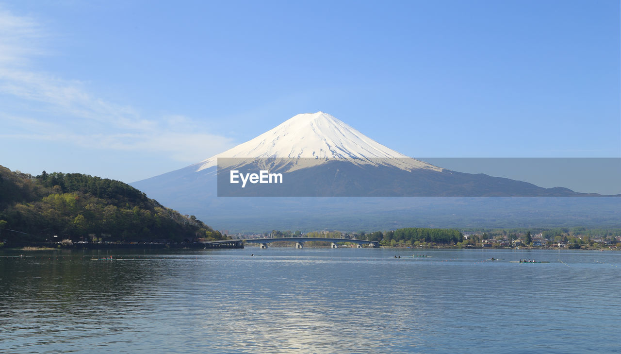 mountain, scenics - nature, sky, beauty in nature, water, volcano, tranquil scene, waterfront, non-urban scene, tranquility, lake, idyllic, nature, travel destinations, no people, snowcapped mountain, day, mountain peak, tree, outdoors, volcanic crater