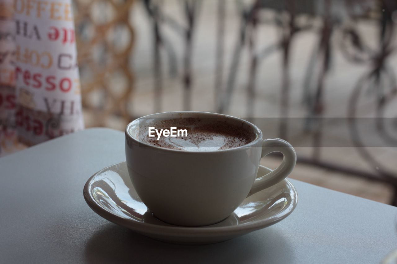 refreshment, food and drink, drink, coffee cup, coffee, mug, coffee - drink, cup, focus on foreground, saucer, crockery, table, still life, close-up, freshness, no people, hot drink, indoors, food, kitchen utensil, non-alcoholic beverage, latte, temptation