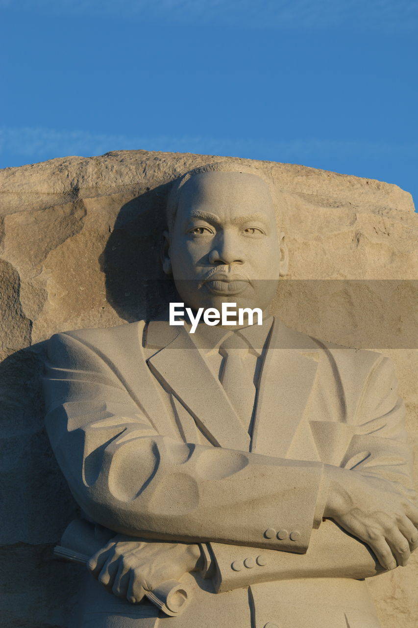 human representation, male likeness, statue, art and craft, sculpture, low angle view, sand, day, sunlight, no people, outdoors, desert, ancient civilization, sky, close-up