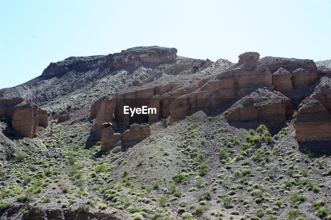 sky, rock, clear sky, rock formation, nature, rock - object, mountain, day, scenics - nature, solid, no people, travel destinations, non-urban scene, travel, history, environment, tranquil scene, land, tranquility, physical geography, outdoors, climate, arid climate, ancient civilization, formation, eroded