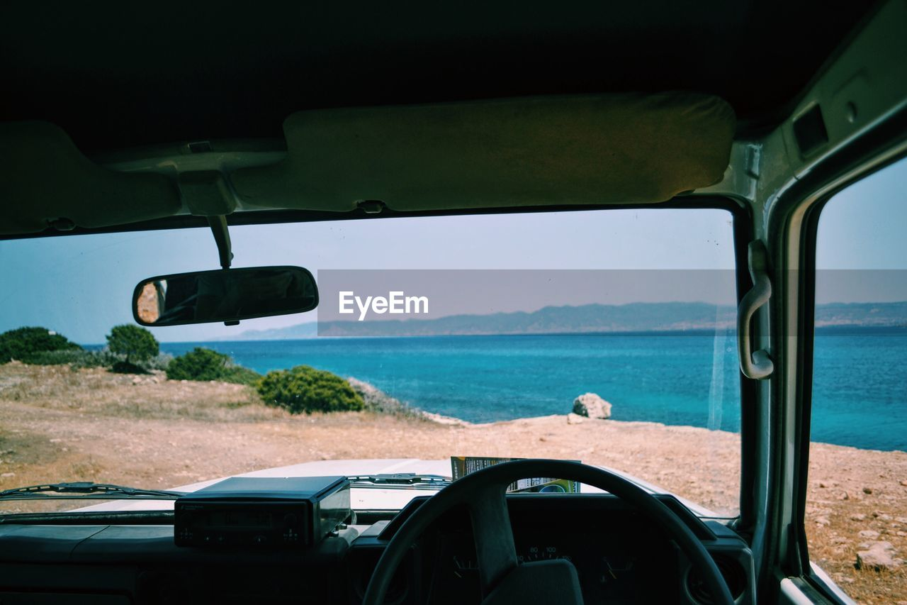 Scenic View Of Sea Seen Through Off-Road Vehicle Windshield
