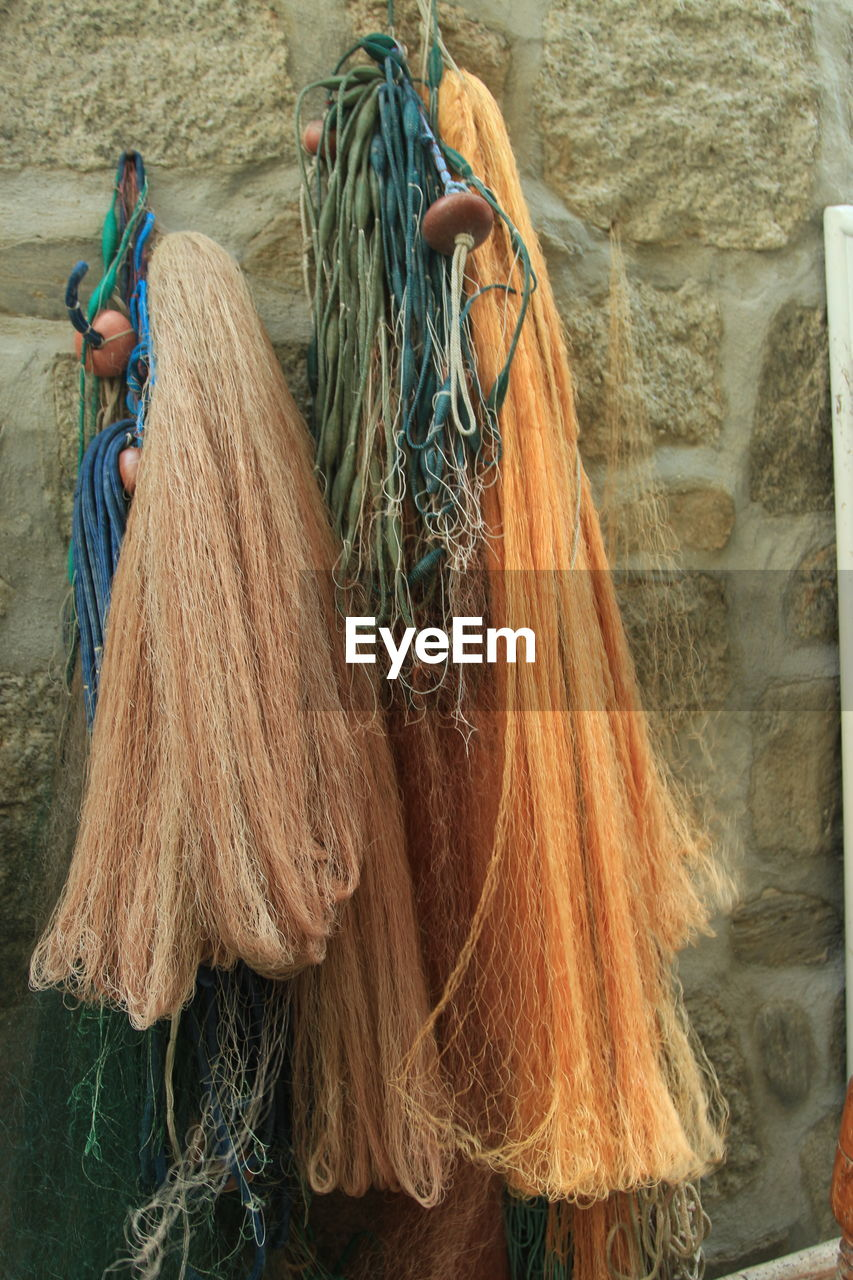 day, fishing net, working, outdoors, one person, fishing equipment, real people, domestic animals, mammal, cleaning equipment, people