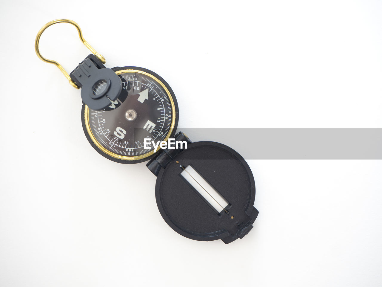 white background, studio shot, indoors, close-up, technology, copy space, black color, still life, high angle view, number, cut out, no people, single object, equipment, circle, geometric shape, time, shape, communication, personal accessory, digital camera, electrical equipment