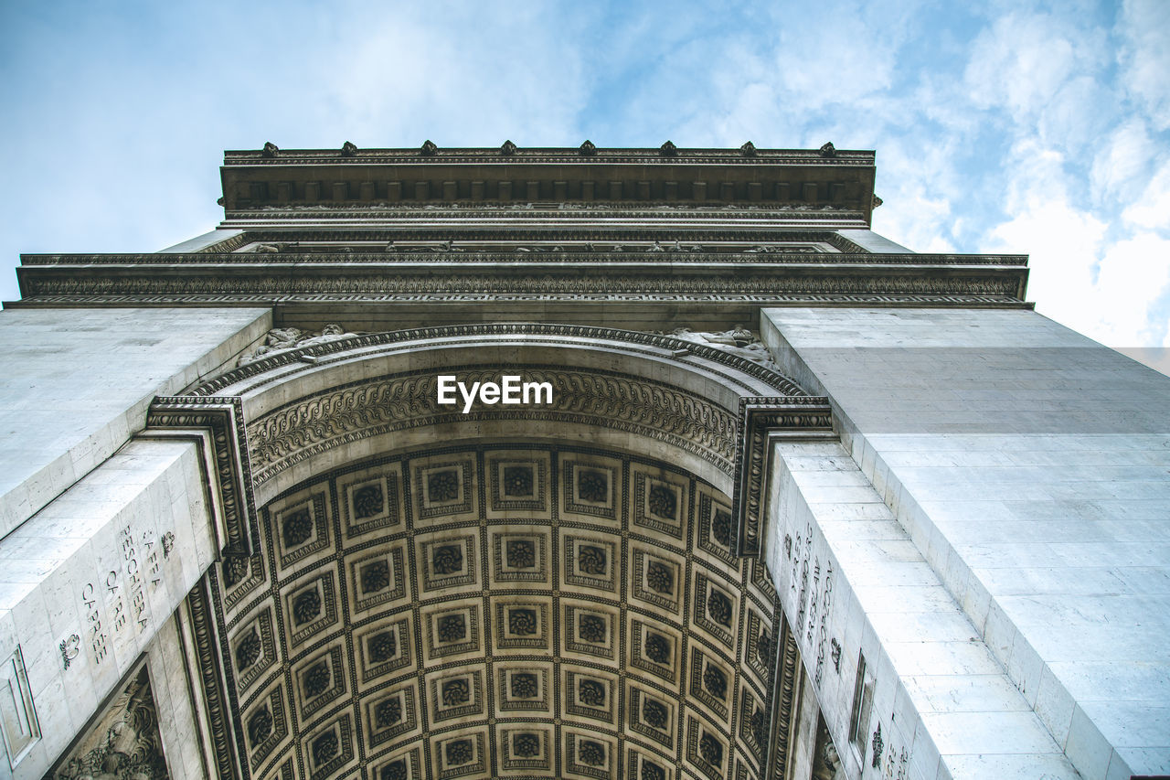 architecture, built structure, building exterior, low angle view, sky, the past, history, no people, day, travel destinations, building, cloud - sky, nature, tourism, arch, travel, city, outdoors, old, architectural column, directly below