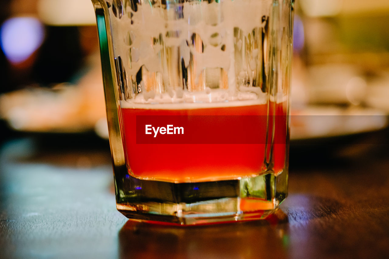 drink, refreshment, glass, food and drink, drinking glass, close-up, alcohol, glass - material, household equipment, focus on foreground, transparent, table, indoors, still life, freshness, beer, no people, beer - alcohol, selective focus, bar - drink establishment, beer glass, bar counter, froth