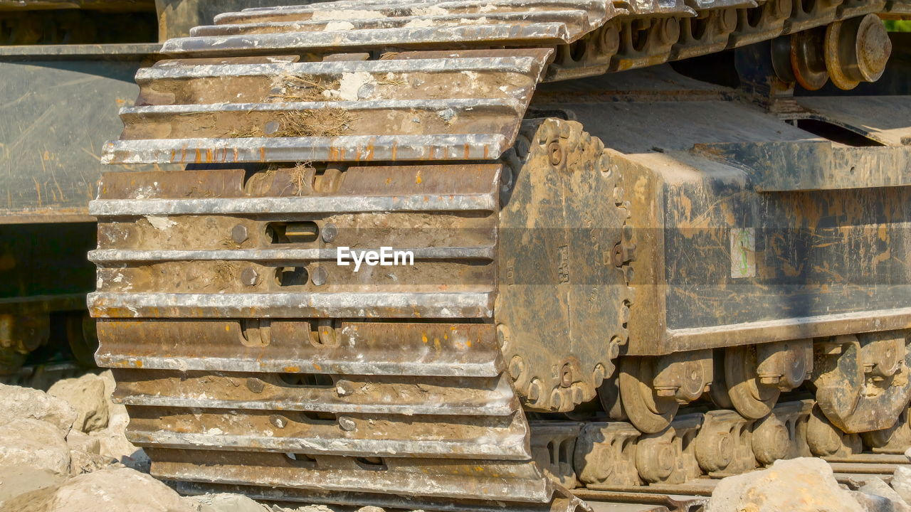stack, industry, day, no people, large group of objects, construction industry, metal, architecture, outdoors, construction site, wood - material, machinery, abundance, equipment, wall - building feature, built structure, timber, nature, construction machinery, staircase, industrial equipment