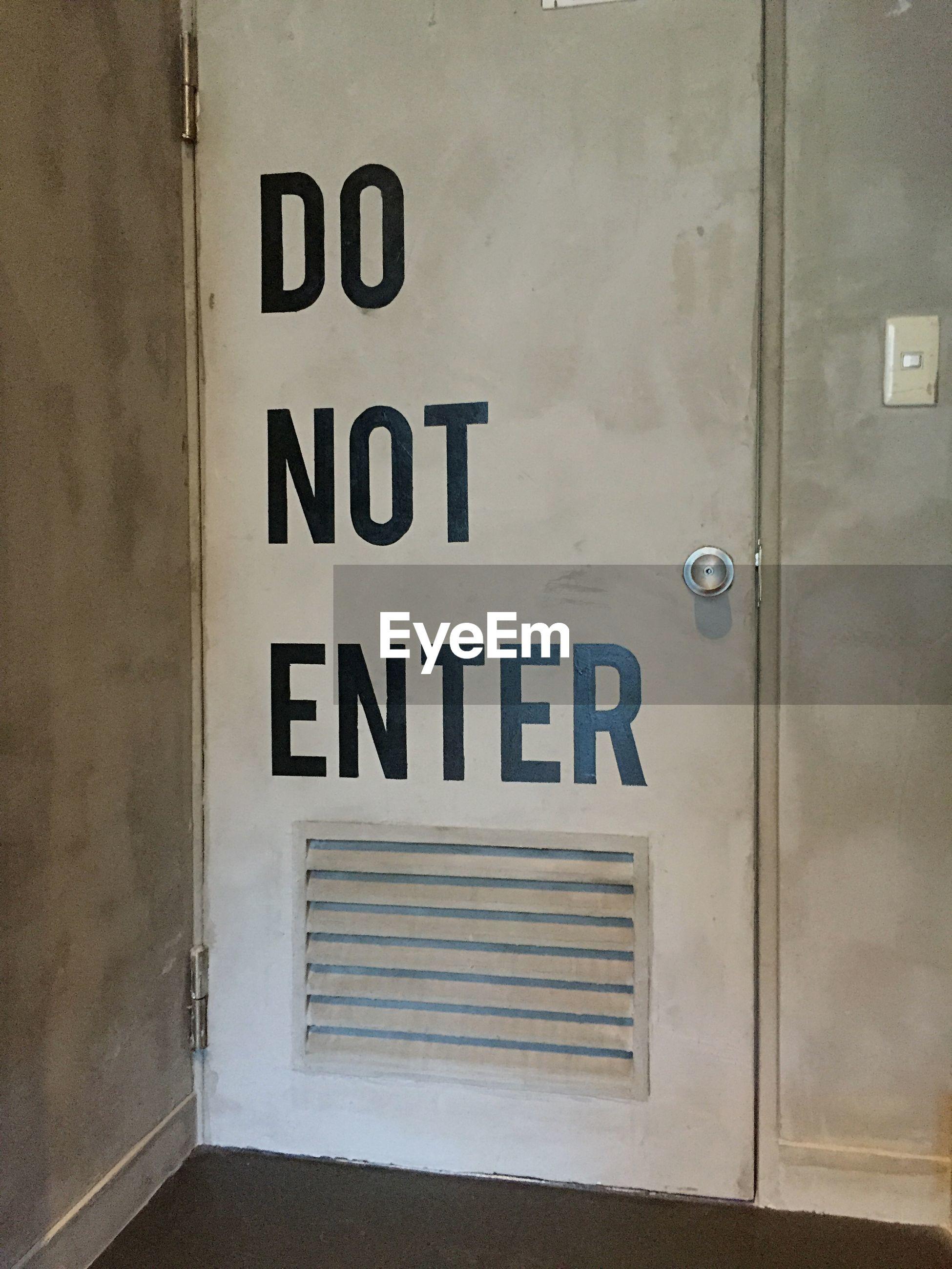 Do not enter sign on wooden door