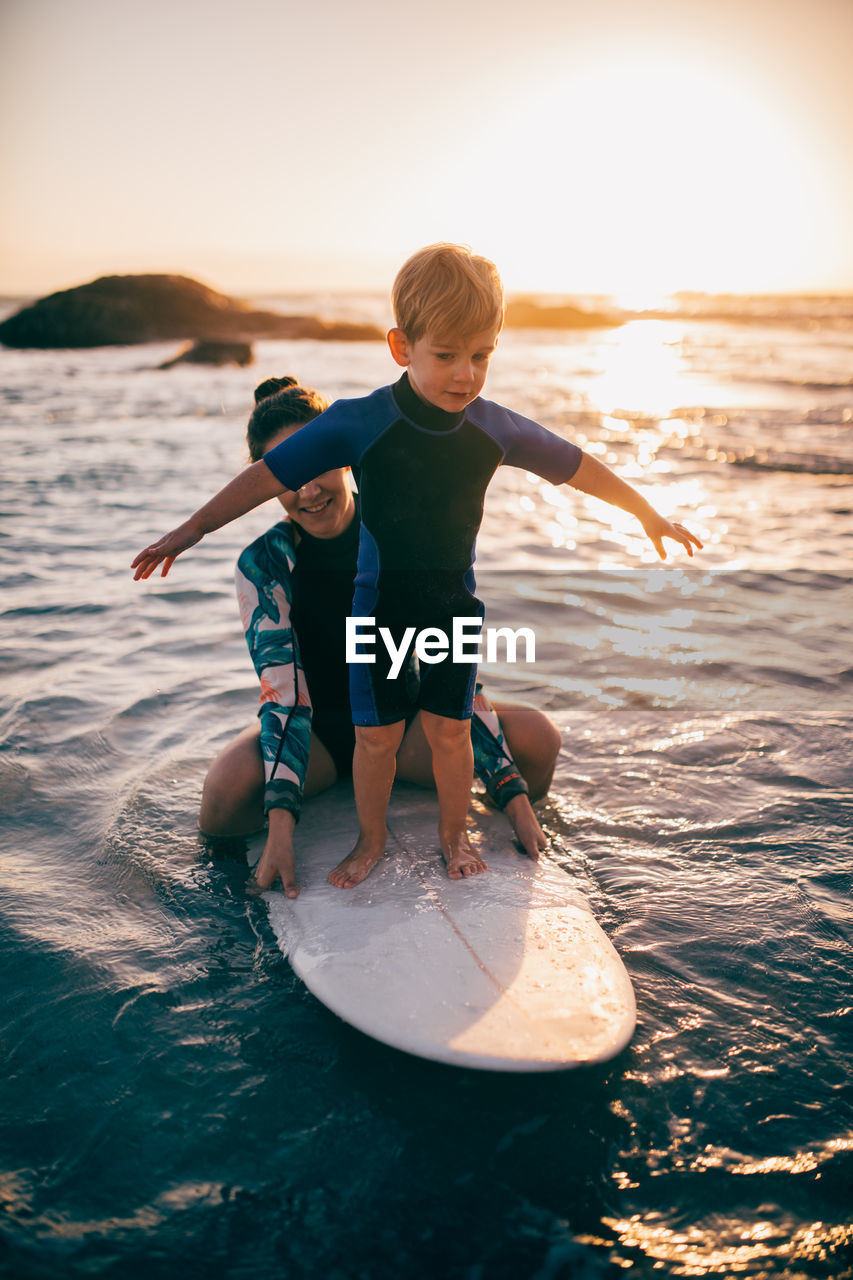 males, child, boys, childhood, water, men, two people, leisure activity, togetherness, real people, full length, sea, family, lifestyles, sunset, bonding, nature, positive emotion, son, innocence