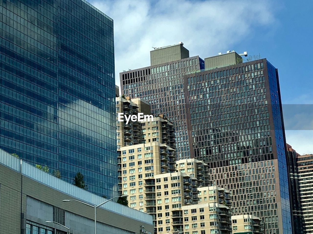 building exterior, built structure, architecture, city, modern, building, office building exterior, office, glass - material, sky, low angle view, skyscraper, day, tall - high, no people, reflection, window, cloud - sky, tower, nature, outdoors, financial district