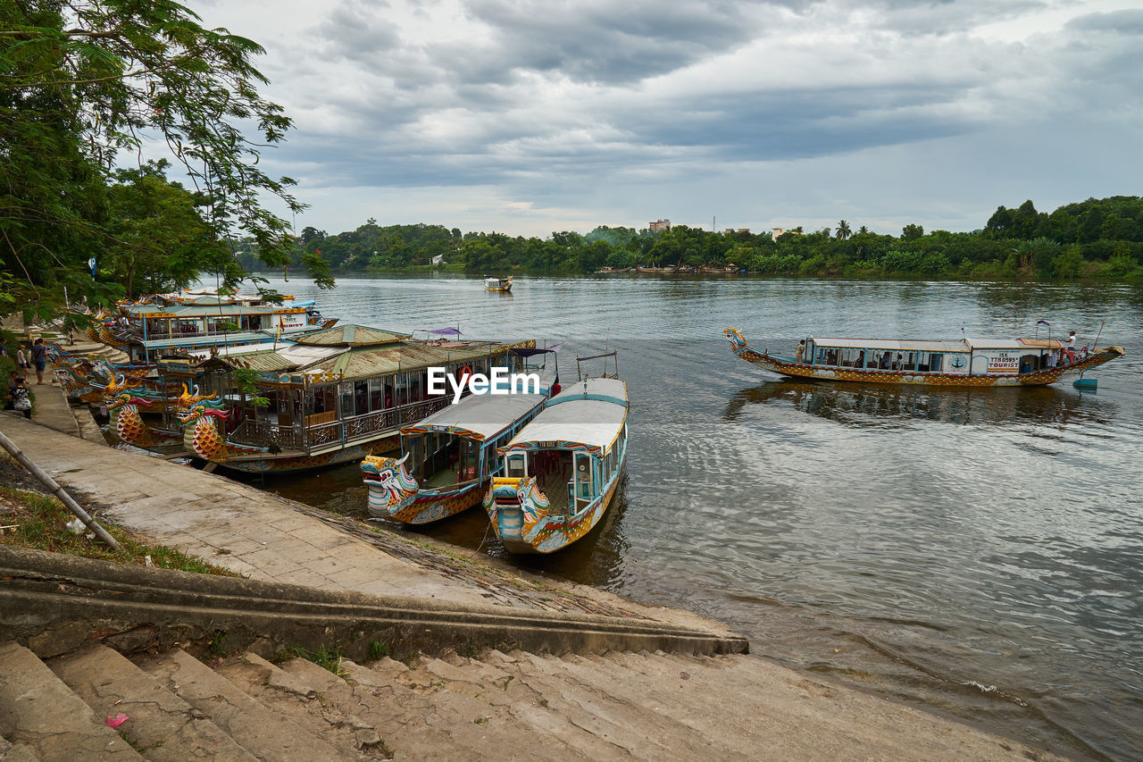 nautical vessel, transportation, mode of transport, water, boat, cloud - sky, sky, nature, moored, river, day, tree, outdoors, no people, scenics, beauty in nature