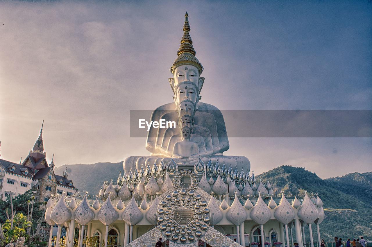 Buddha statues against sky